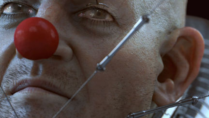 * The clown and its strings -close up *